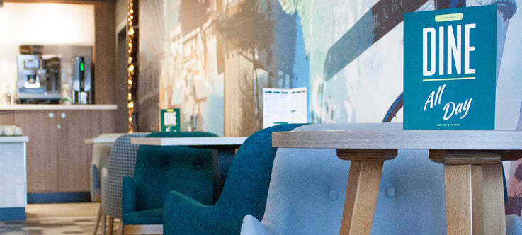 Teal and Greu Tub Chairs in Bar Area of Hotel