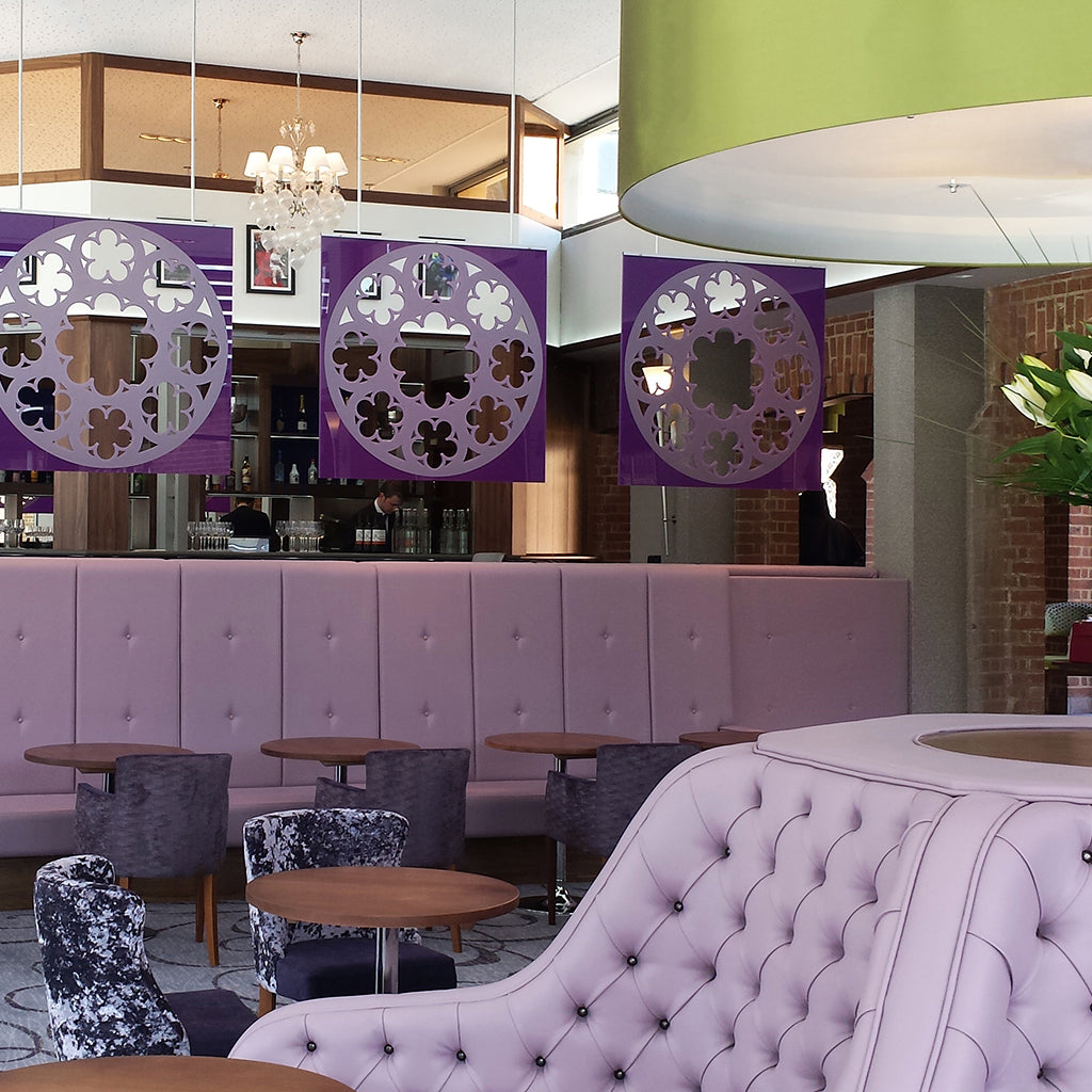Bespoke banquette seating in purple faux leather with waterfall arms