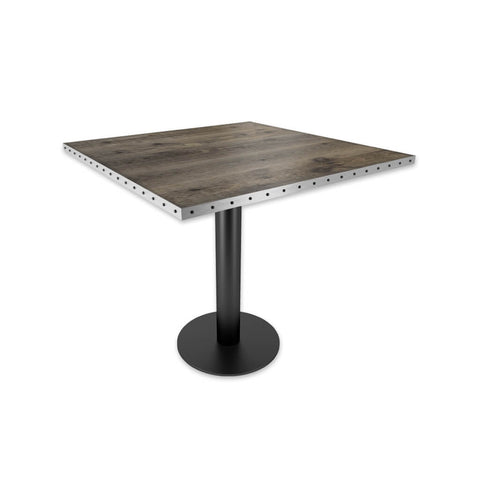 Copito grey bar table with metal trim top and black pedestal base. 1107