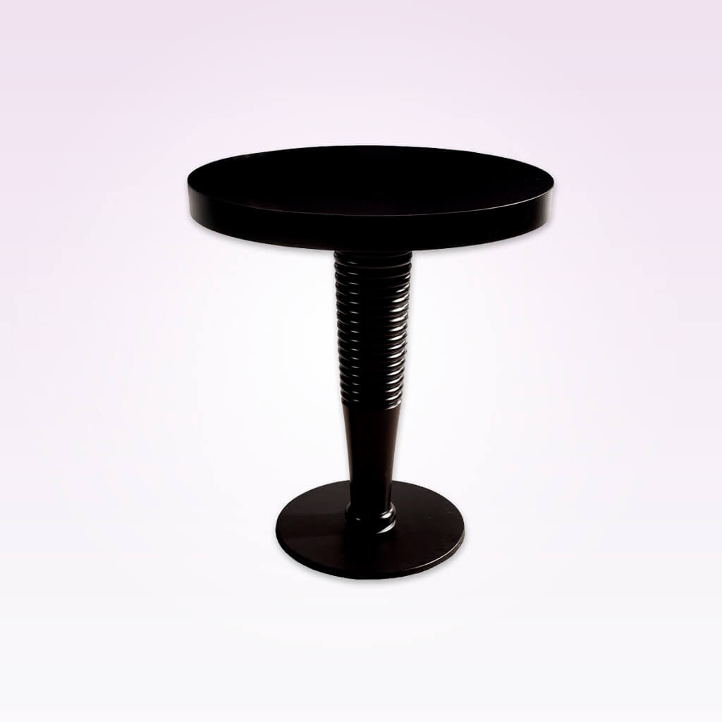 Galini modern black dining table with ridge detail to the pedestal and round top. 1115
