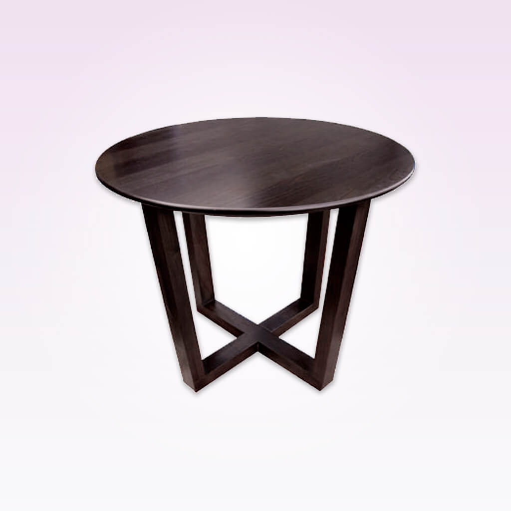 Patriki dark brown wood dining table with cross base and round top. 1136