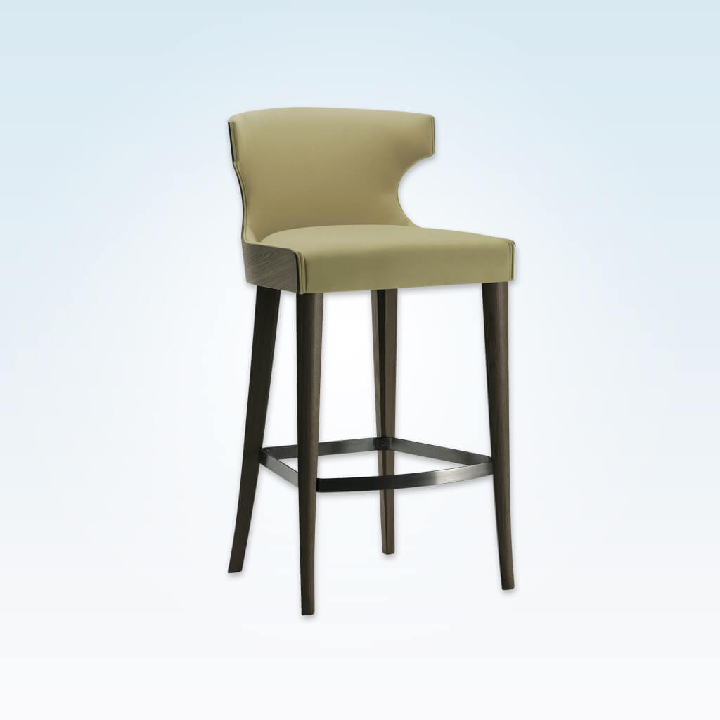 Una green bar stool with hammer head back rest and show wood rear. Featuring tapered legs and curved kick plate 6052 BR1