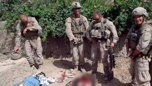 Marine who peed on dead Taliban wins in court
