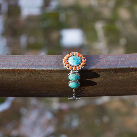 "7.5"" Reconstituted Turquoise and Coral Sunburst Toggle Bracelet"