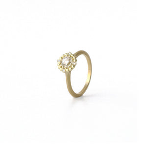 Vintage style orb halo diamond yellow gold ring