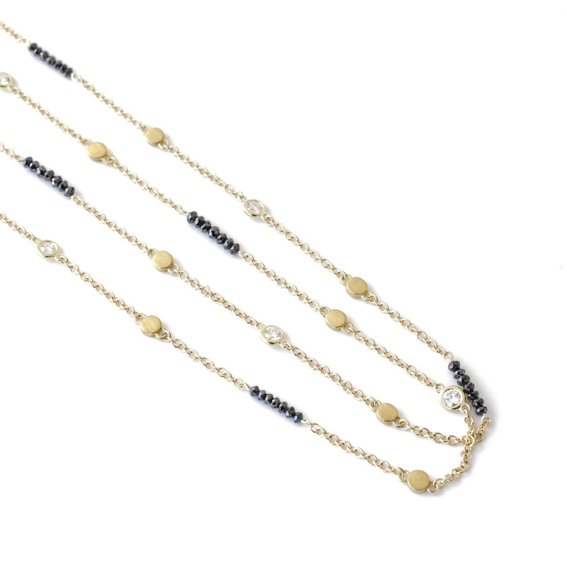 black and white diamond chain in 18k gold