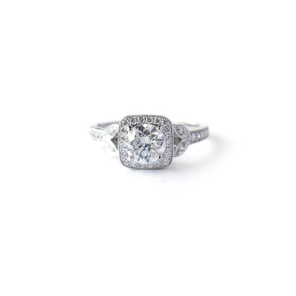 Vintage style cushion halo engagement ring