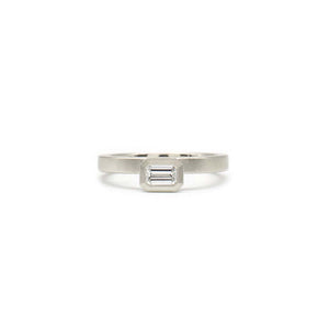 White Offset Emerald Cut Ring