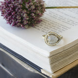 Pear shape pale sapphire cognac diamond ring