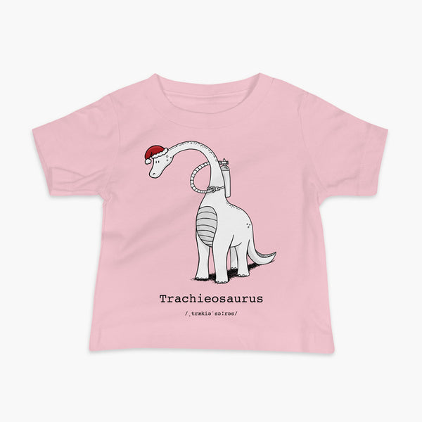 A Christmas dinosaur or trachieosaurus with a trach or tracheostomy and oxygen with a Christmas Santa hat with a stoma on a pink infant t-shirt