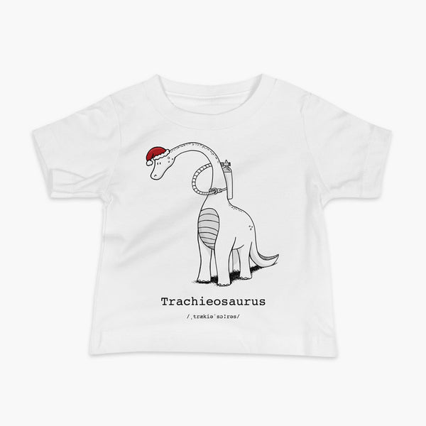 A Christmas dinosaur or trachieosaurus with a trach or tracheostomy and oxygen with a Christmas Santa hat with a stoma on a white infant t-shirt