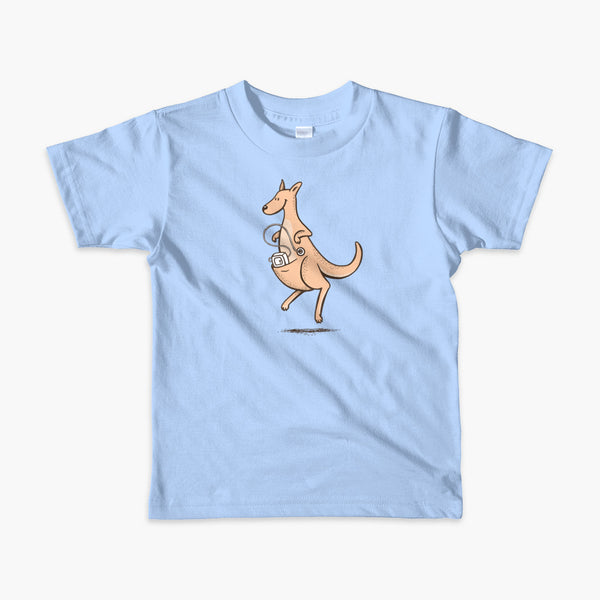 A happy orange tube tubie kangaroo hops along with her Joey feeding pump and feeding tube sitting in her pouch with a g-tube on a blue kids t-shirt