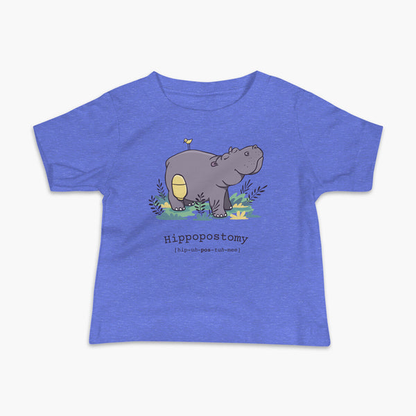 A Hippo or Hippopotamus with an ostomy bag — also known as a Hippopostomy. He is standing in some foliage smiling and has a bird on his back on a blue infant t-shirt.