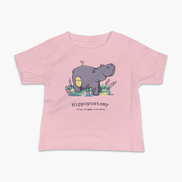 A Hippo or Hippopotamus with an ostomy bag — also known as a Hippopostomy. He is standing in some foliage smiling and has a bird on his back on a pink infant t-shirt.