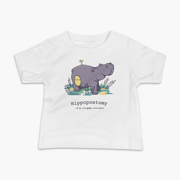 A Hippo or Hippopotamus with an ostomy bag — also known as a Hippopostomy. He is standing in some foliage smiling and has a bird on his back on a white infant t-shirt.