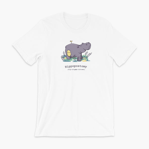 A Hippo or Hippopotamus with an ostomy bag — also known as a Hippopostomy. He is standing in some foliage smiling and has a bird on his back on a white adult t-shirt.