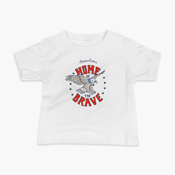 A patriotic American bald eagle with a trach or tracheostomy for the 4th of July and the words StomaStoma Home of the Brave and stars on a white infant t-shirt