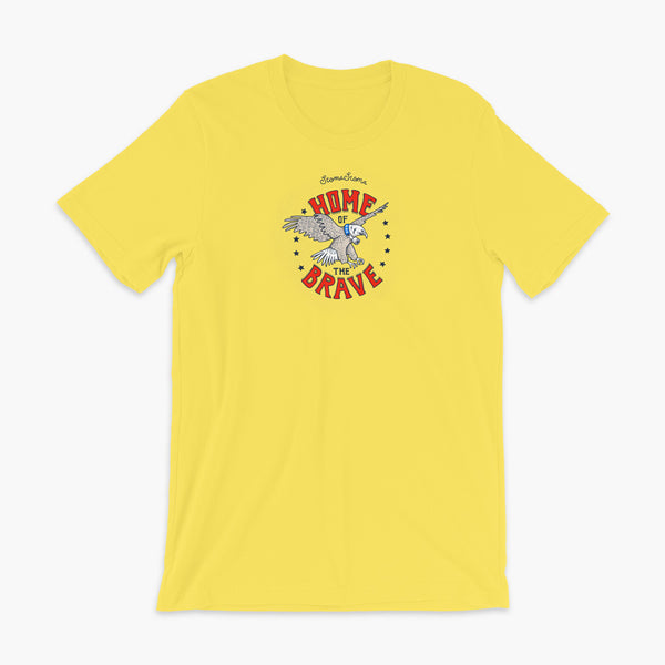 A patriotic American bald eagle with a trach or tracheostomy for the 4th of July and the words StomaStoma Home of the Brave and stars on a yellow adult t-shirt