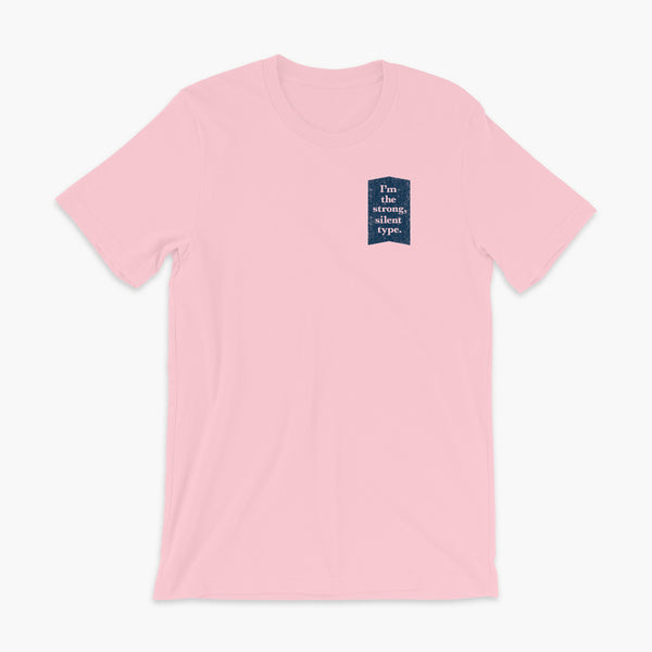 Text on a dark blue background that says I'm the strong, silent type on a pink adult t-shirt