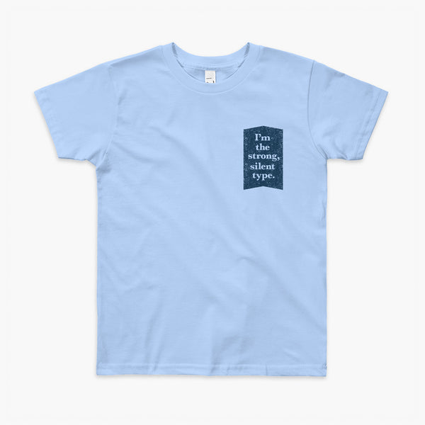 Text on a dark blue background that says I'm the strong, silent type on a baby blue youth t-shirt