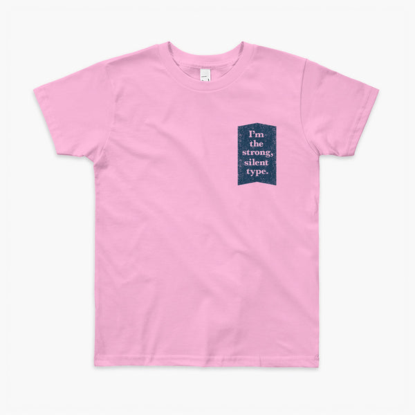 Text on a dark blue background that says I'm the strong, silent type on a pink grey youth t-shirt