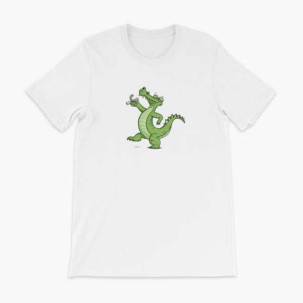 A green alligator or crocodile walks confidently with a big smile after bing decannulated of trach free. It is holding the trach in his hand. One a white adult t-shirt