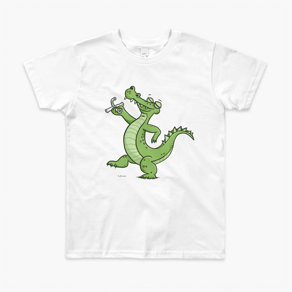 A green alligator or crocodile walks confidently with a big smile after bing decannulated of trach free. It is holding the trach in his hand. One a white youth t-shirt