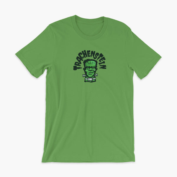 A Frankenstein with a trach or tracheostomy is called a Trachenstein! He has bolts in his neck and an HME on trach in his stoma. On a leaf green adult t-shirt