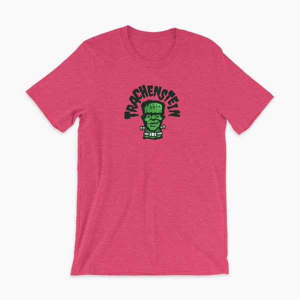 A Frankenstein with a trach or tracheostomy is called a Trachenstein! He has bolts in his neck and an HME on trach in his stoma. On a heather raspberry adult t-shirt