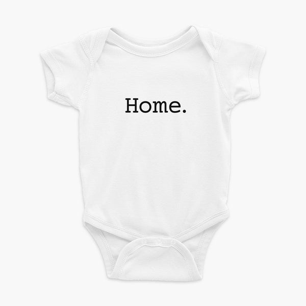 Simply the word home. On the center of the t-shirt on a white infant onesie