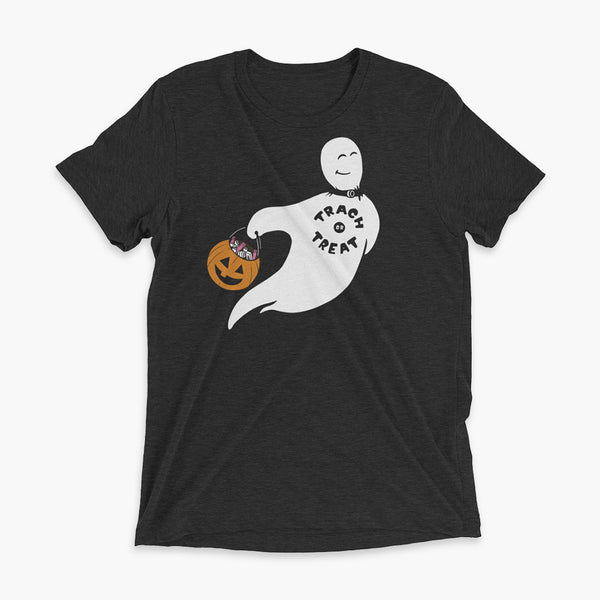 A white ghost with a trach wearing a trach or treat shirt holding a halloween bucket of trachs and saline on a black adult triblend t-shirt