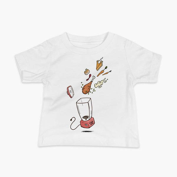 A Thanksgiving dinner getting thrown into a blender - a turkey leg, mashed potatoes, carrots, pumpkin pie and bread on a white infant t-shirt. A meal for those who are living the Tube Life with a Stoma.