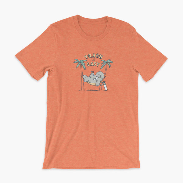 An elephant with a trach or tracheostomy and connected to an oxygen tank sits in a hammock between two palm trees with his nose around a drink just trachin' it easy and relaxing on a heather orange adult t-shirt