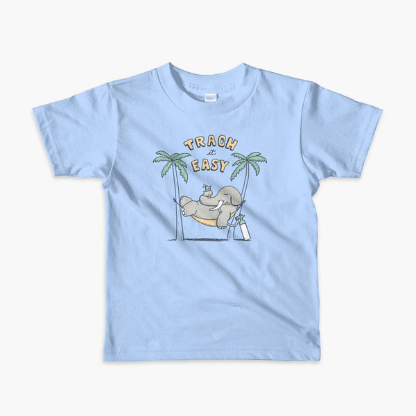 An elephant with a trach or tracheostomy and connected to an oxygen tank sits in a hammock between two palm trees with his nose around a drink just trachin' it easy and relaxing on a blue kid's t-shirt