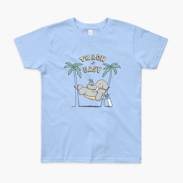 An elephant with a trach or tracheostomy and connected to an oxygen tank sits in a hammock between two palm trees with his nose around a drink just trachin' it easy and relaxing on a blue youth t-shirt