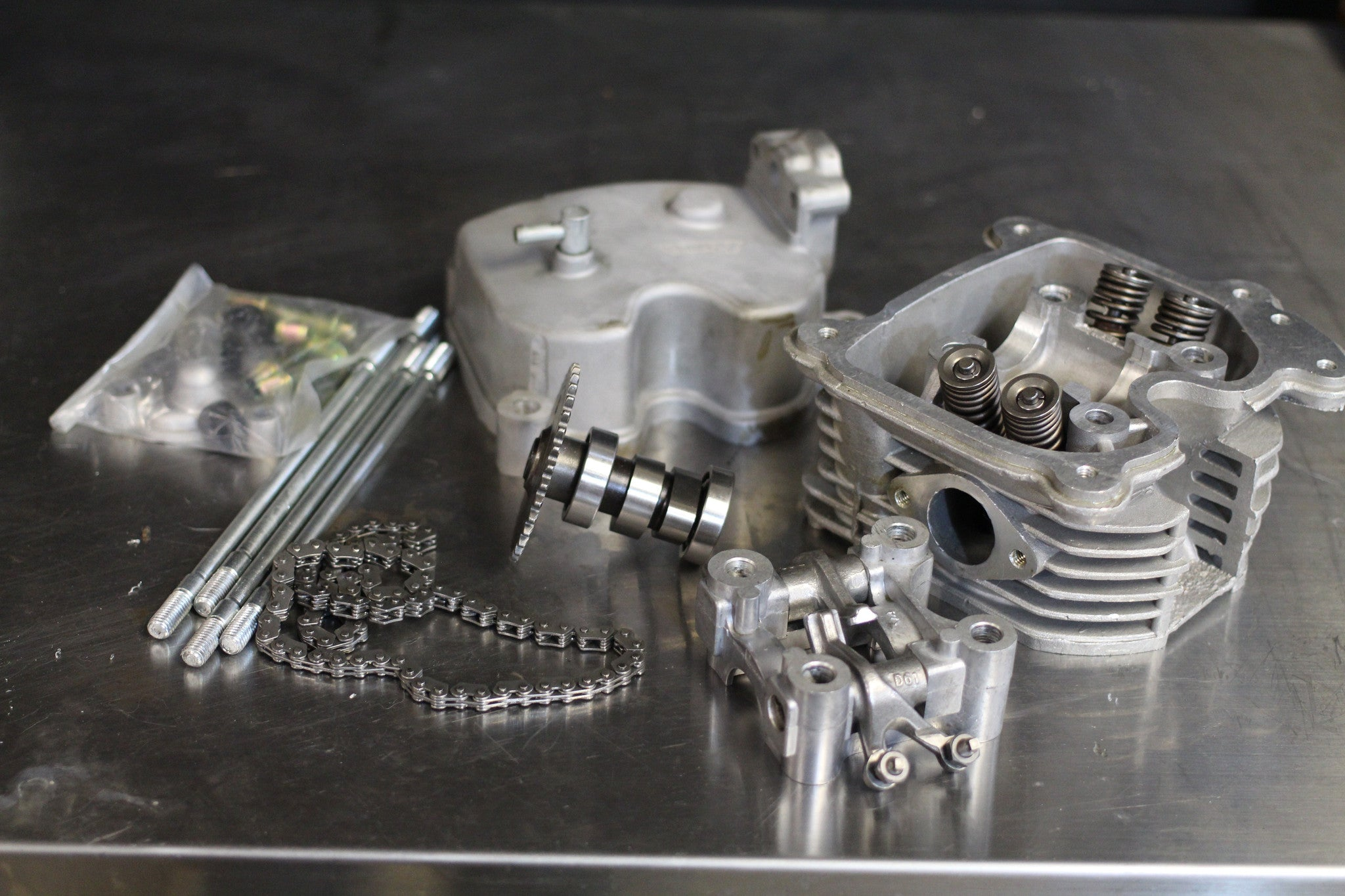 GY6 4 valve cylinder head with 4v big bore piston – Rolling