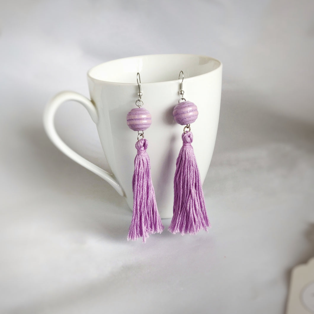 Purple Tassels, Purple Beads, Dangle Earrings hanging on a cup