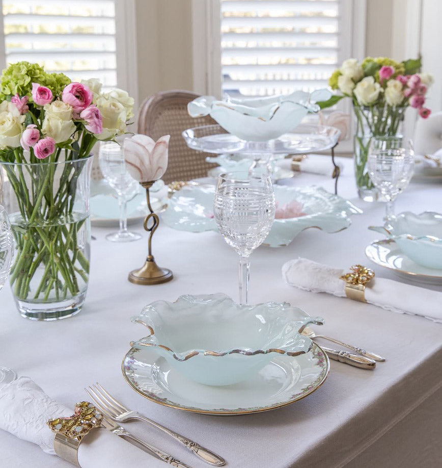 Gorgeous tablesetting for easter, colorful flowers, frosted bowls for the dinnerware