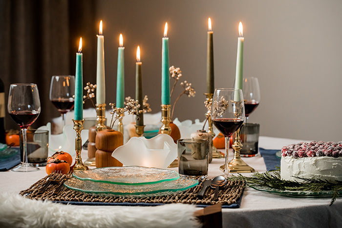 Hanukkah table setting with candles and Annieglass salt collection