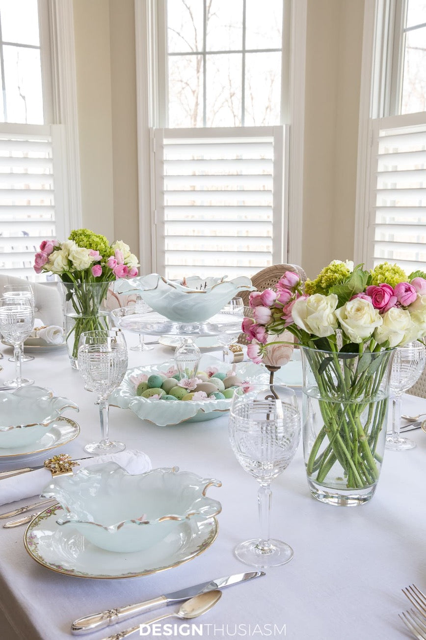 Easter table setting with Annieglass poppy bowls and spring flowers