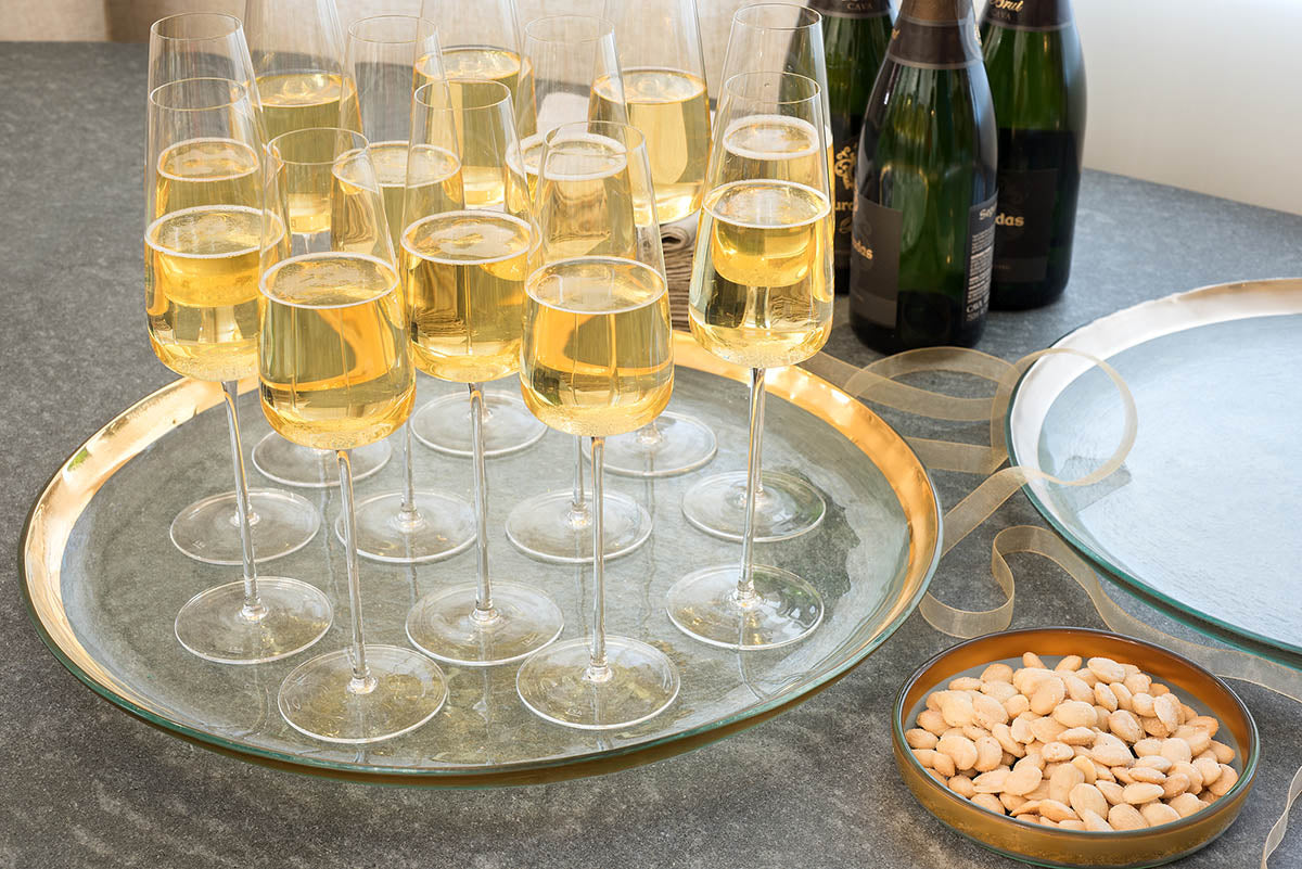 Annieglass round platter, 24k gold bank with champagne glasses