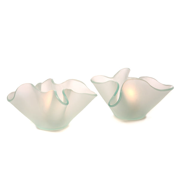 This frosted glass votive celebrates the beauty of slumped glass with free form folds.