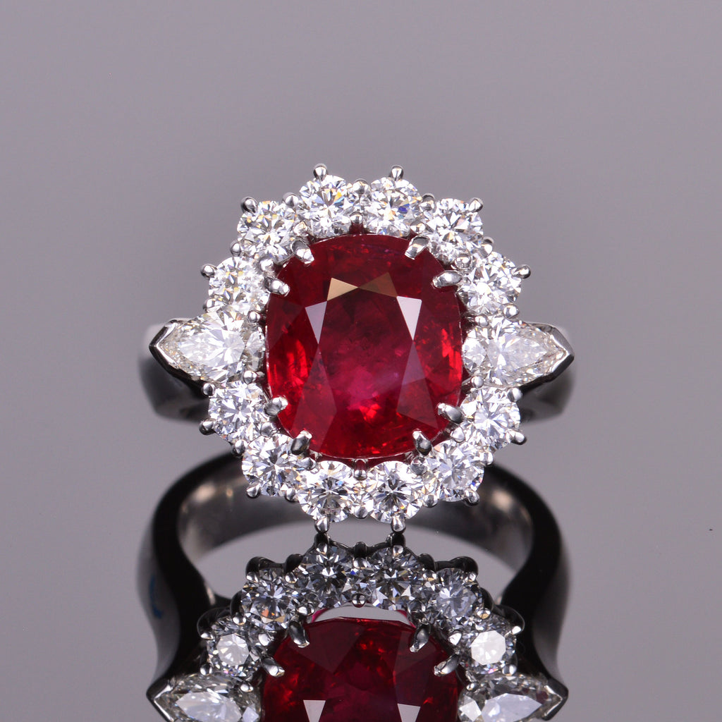 cushion cut ruby ring with diamond halo in platinum