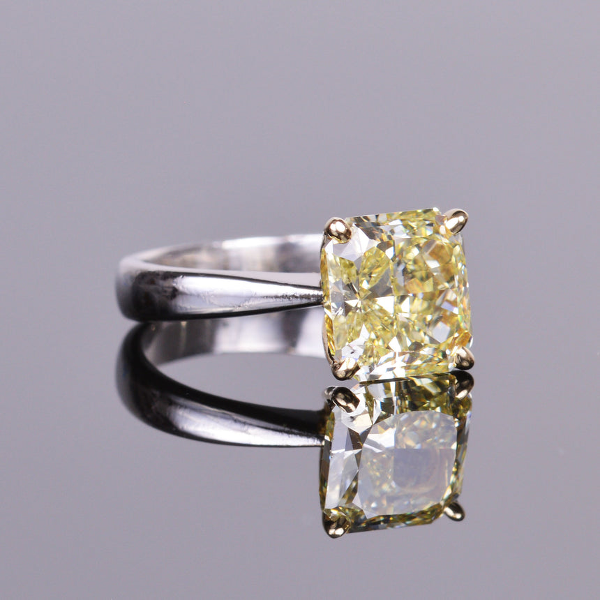 yellow diamond radiant solitaire ring in platinum