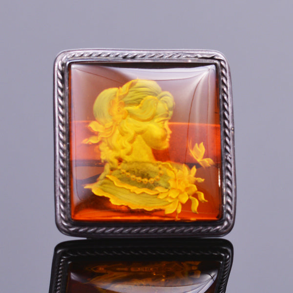 Hand carved amber cameo ring in sterling silver