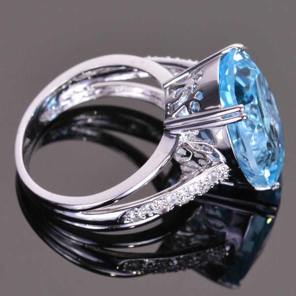 Oval Blue Topaz and White Sapphire Ring