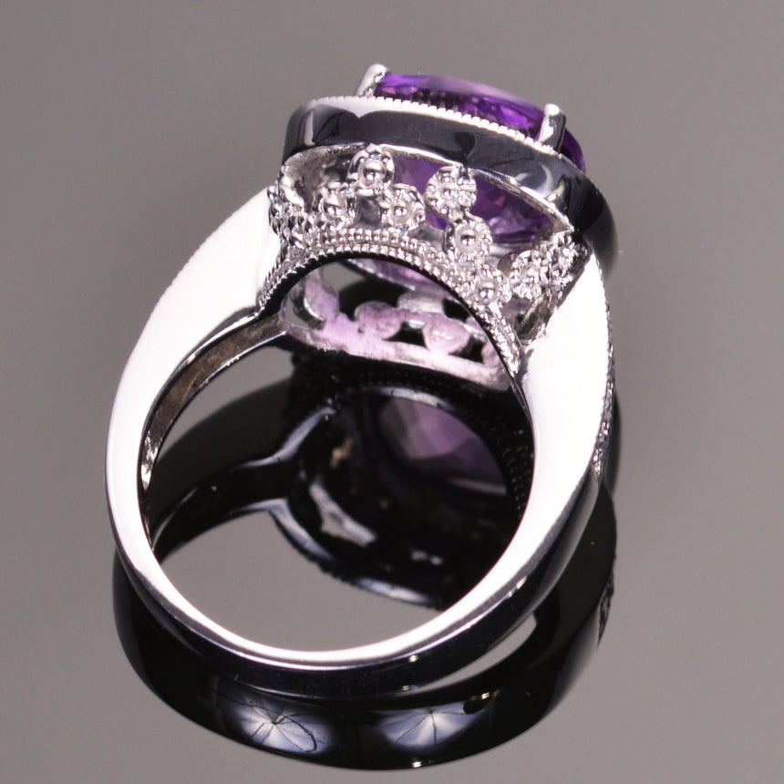 cushion amethyst ring with diamond halo in white gold.