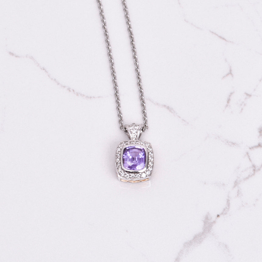 purple sapphire and diamond pendant in yellow and white gold