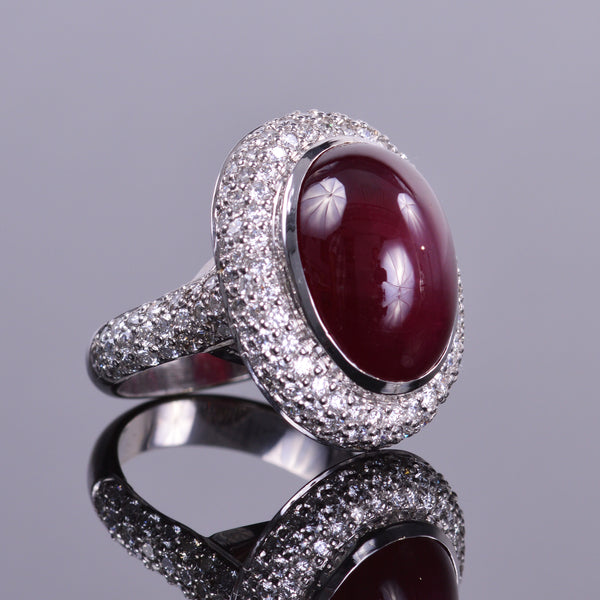 Ruby Cabochon Diamond Ring with a Pave Halo