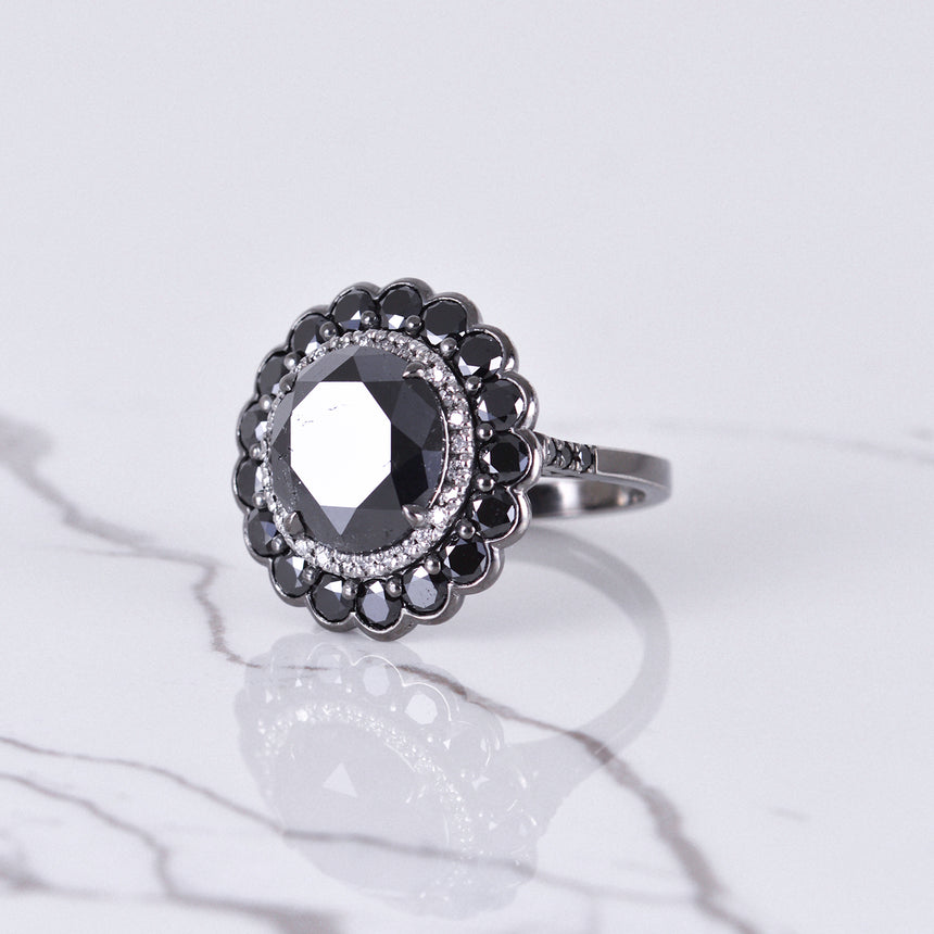 black and white diamond flower ring in white gold